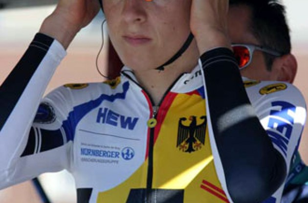 Arndt adjusts her helmet seconds before take off. Photo copyright Paul Sampara Photographics.