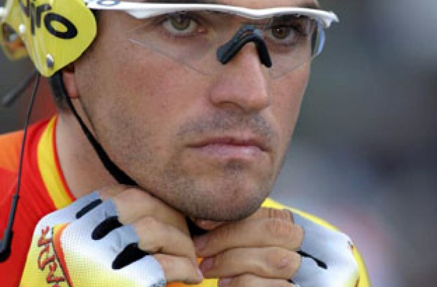 A concentrating Gonzalez de Galdeano adjusts his helmet strap. Photo copyright Paul Sampara Photography.