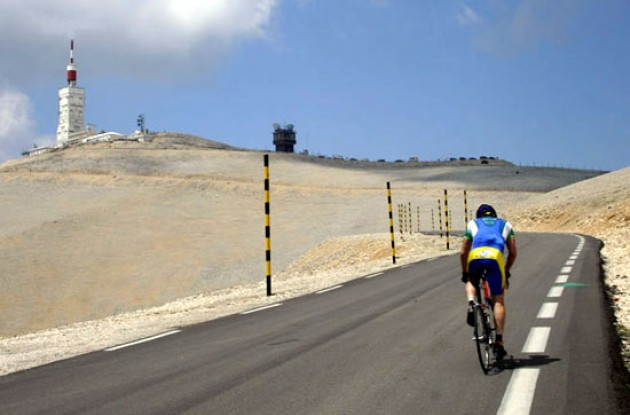 Grinding past Tom Simpson's resting spot. Photo copyright Roadcycling.com.