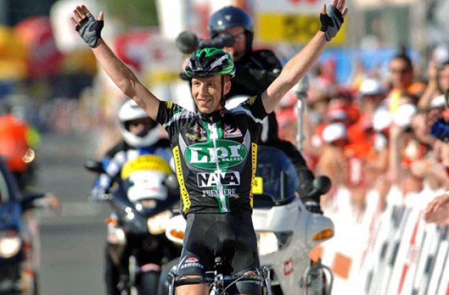 Contrini takes the stage win after a long solo ride. Photo copyright Fotoreporter Sirotti.