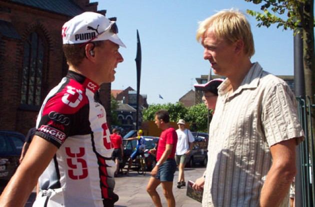 "Team CSC's Michael Sandstød talks with team mate ""Mr. Attack"" Jakob Piil. Hey Jakob...let's have a barbecue one of these days... Photo copyright Roadcycling.com."