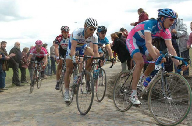 The Boonen-Cancellara group riding hard on a pavé-section. Photo copyright Fotoreporter Sirotti.