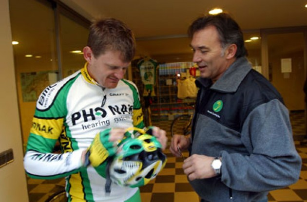 Floyd Landis adjusts his new Phonak helmet. Photo copyright Murphy Heiniger.