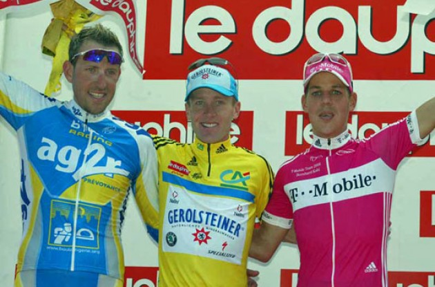 The overall top 3 on the podium in Grenoble. Levi Leipheimer, Moreau, and Kohl. Photo copyright Fotoreporter Sirotti.