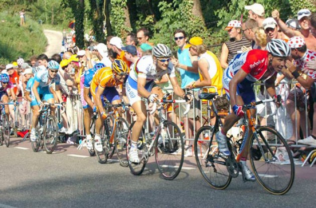 Boonen and co. follows. Photo copyright Fotoreporter Sirotti.