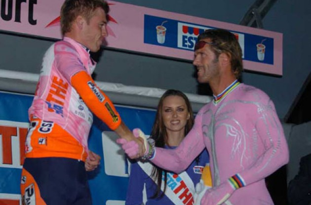 Lancaster and Cipollini (AKA Lion King) on the podium. Pretty in pink? Photo copyright Fotoreporter Sirotti.