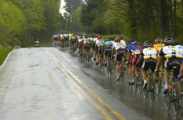 The peloton chases the break during the major downpour of the day. Photo copyright Casey Gibson.