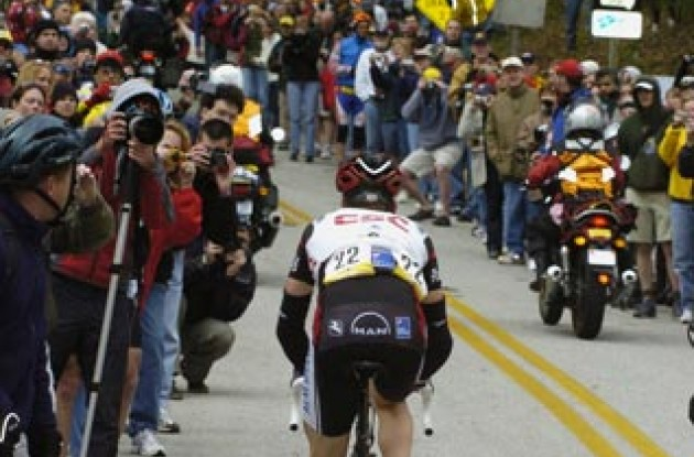 Christian VandeVelde of Team CSC starts the final climb in front of huge crowds. Photo copyright Casey Gibson.