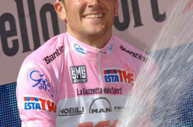 Ivan Basso on the podium. Photo copyright Fotoreporter Sirotti.