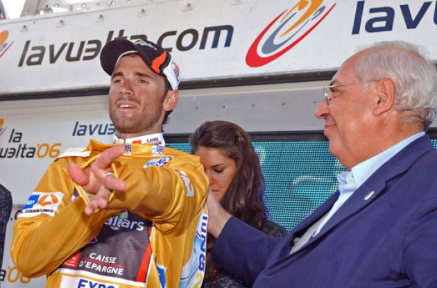 Valverde gets to put on the golden jersey. Photo copyright Roadcycling.com.