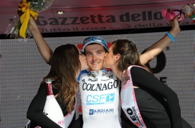 Domenico Pozzovivo receives his reward from the podium babes on the podium. Photo Fotoreporter Sirotti.