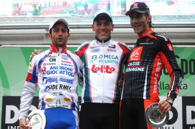 Philippe Gilbert on the 2010 Tour of Lombardy podium with Scarponi and Lastras.