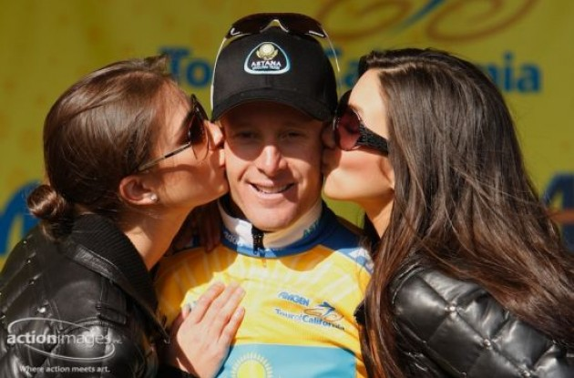 Levi Leipheimer on the podium with the beautiful podium girls. Wanna switch places? Photo copyright Ben Ross / Action Images Inc.