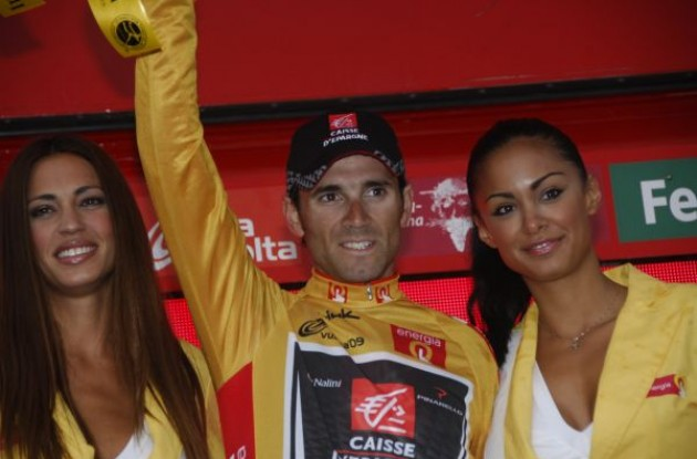Alejandro Valverde on the podium with the beautiful Spanish podium girls. Photo copyright Fotoreporter Sirotti.