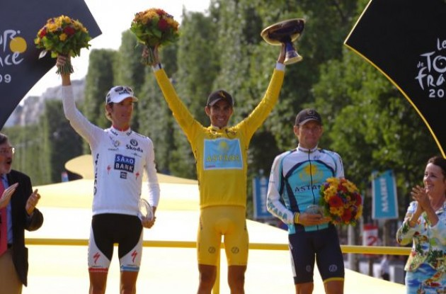 The top 3 on the podium. Alberto Contador (Team Astana), Andy Schleck (Team Saxo bank) and last but definitely not least Lance Armstrong (Team Astana). Photo copyright Fotoreporter Sirotti.