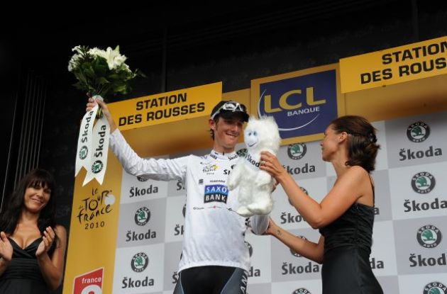 Young podium girls up for grabs for the young rider classification leader Andy Schleck. Photo copyright Fotoreporter Sirotti.