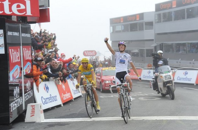 Andy Schleck crosses the finish line first. Photo copyright Fotoreporter Sirotti.