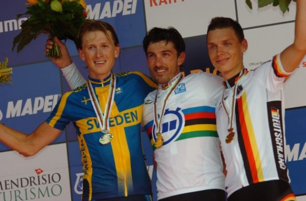 Fabian Cancellara (Switzerland), Gustav Erik Larsson (Sweden), and Tony Martin (Germany) on the podium - with no podium girls? Photo copyright Fotoreporter Sirotti.