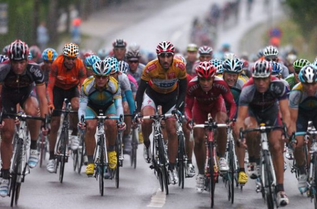 Cancellara, Horner and Vinokourov in the rainy stage 4 of the 2009 Vuelta a Espana. Photo copyright Fotoreporter Sirotti.
