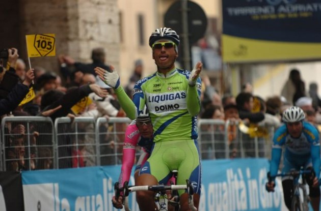 Podium girls here I come! Daniele Bennati wins stage three of the 2010 Tirreno Adriatico. Photo copyright Fotoreporter Sirotti.