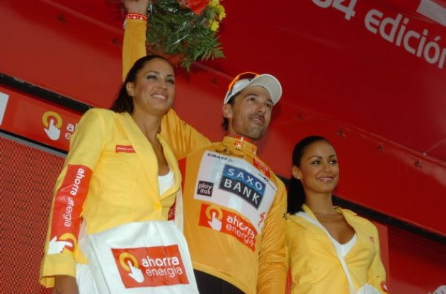 Fabian Cancellara on the podium with the well-equipped Spanish podium girls. Photo copyright Fotoreporter Sirotti.