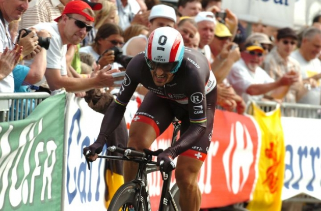 Fabian Cancellara powers to individual prologue victory in 2012 Tour de France for Team RadioShack-  Nissan ahead of Team Sky Procycling's Bradley Wiggins and Sylvain Chavanel of Team Omega Pharma-  QuickStep. Photo Fotoreporter Sirotti.