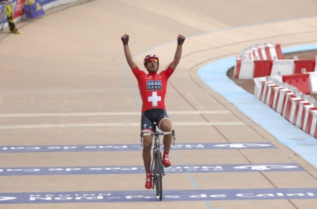 Team Saxo Bank's Fabian Cancellara wins the 2010 Paris-Roubaix. Photo copyright Fotoreporter Sirotti.