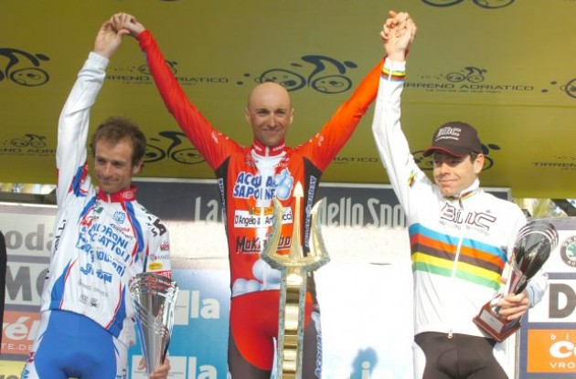 Stefano Garzelli, Michele Scarponi and Cadel Evans on the podium. Photo copyright Fotoreporter Sirotti.