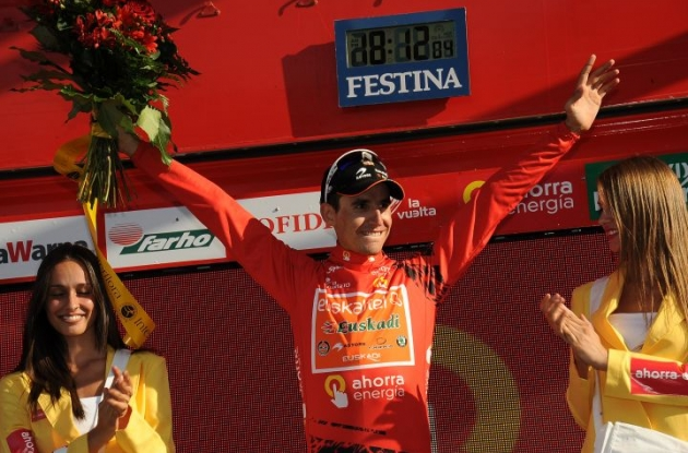 Igor Anton still leads the Vuelta overall and gets some quality time with the Spanish podium girls. Photo copyright Fotoreporter Sirotti.