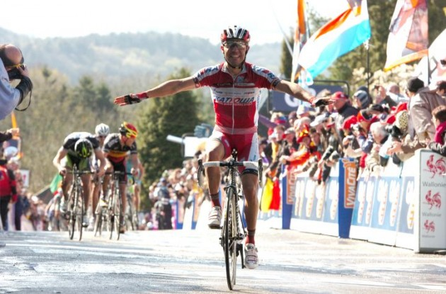 Joaquim Rodriguez climbs to victory in La Fleche Wallonne 2012 beating Team GreenEdge's Michael Albasini and Philippe Gilbert of Team BMC Racing. Photo Fotoreporter Sirotti.