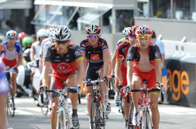 Team RadioShack's Janez Brajkovic pulls Lance Armstrong across the finish line. Photo copyright Fotoreporter Sirotti.