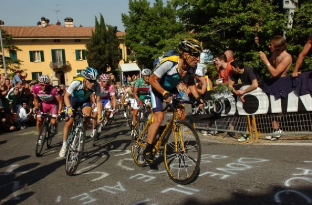 Lance Armstrong and Levi Leipheimer (Both Team Astana) closely followed by a suffering Danilo Di Luca (LPR Brakes). Photo copyright Fotoreporter Sirotti.