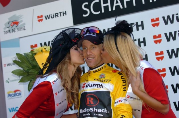 Team RadioShack's Levi Leipheimer celebrates his 2011 Tour de Suisse victory on the podium with the Swiss podium babes. Photo Fotoreporter Sirotti.