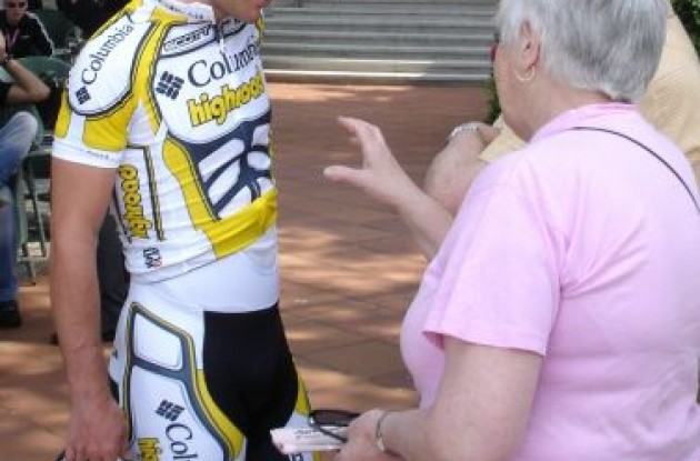 Mark Cavendish listens to British granny give him advise just before he starts time trial warm-up. Photo by Andrew Ward.