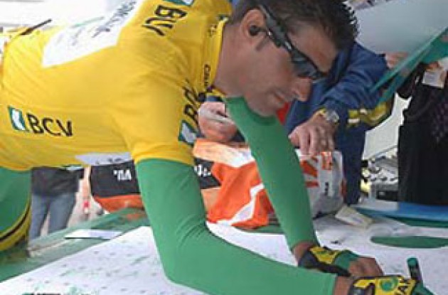 Oscar Pereiro signs in. Photo copyright Roadcycling.com.
