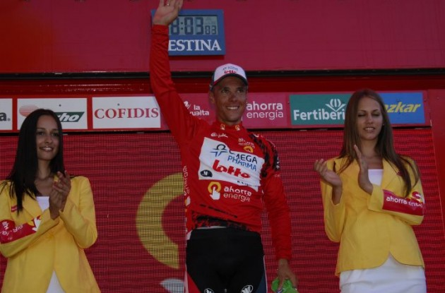 Philippe Gilbert celebrates his Vuelta lead on the podium with the beautiful Spanish podium girls. Photo copyright Fotoreporter Sirotti.