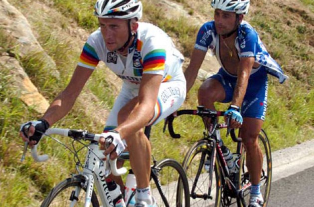 Davide Rebellin and Paolo Bettini working hard on the last climb. Photo copyright Fotoreporter Sirotti.