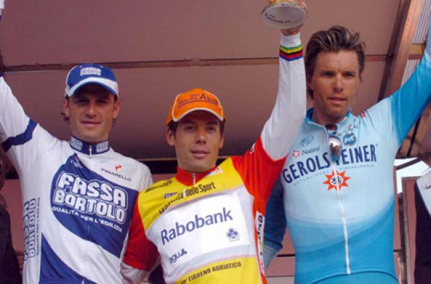 The overall top 3 on the podium. Petacchi, Freire and Hondo (later replaced by Guidi). Photo copyright Fotoreporter Sirotti.