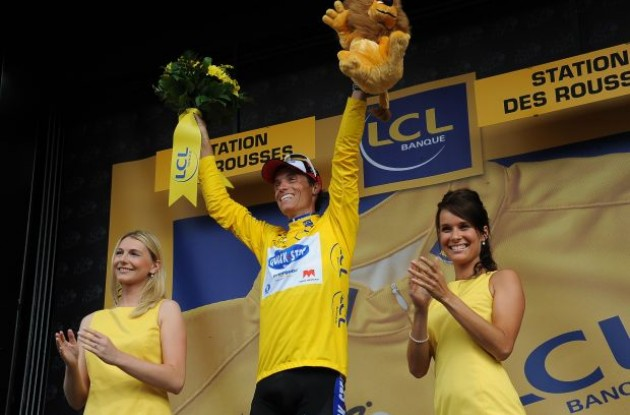 Sylvain Chavanel leads the Tour de France overall..so he gets some quality time with the podium girls. Photo copyright Fotoreporter Sirotti.