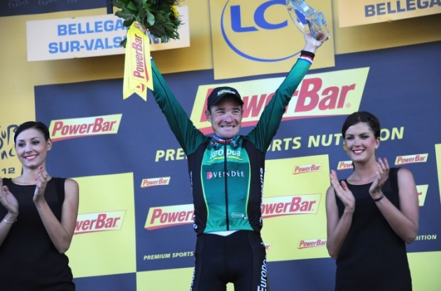 A proud and moved Thomas Voeckler of Team Europcar is celebrated on the podium in France. Photo Fotoreporter Sirotti.
