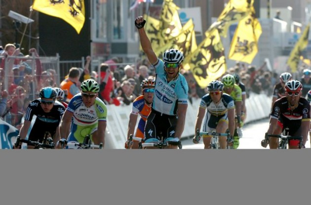 Tom Boonen of Team Omega Pharma-QuickStep powers to victory in Gent-Wevelgem 2012 ahead of Peter Sagan of Team Liquigas-Cannondale and Matti Breschel from Team Rabobank. Photo Fotoreporter Sirotti.