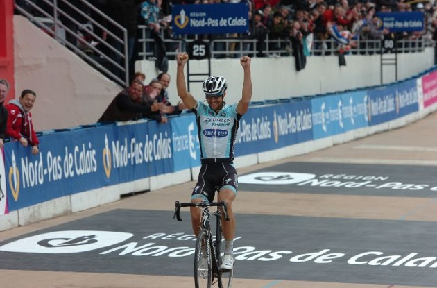 Team Omega Pharma-QuickStep's Tom Boonen powers to solo victory in Paris-Roubaix 2012 ahead of Sebastien Turgot of Team Europcar and Team BMC Racing's Alessandro Ballan. Photo Fotoreporter Sirotti.
