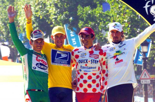 The four jersey winners on the podium in Paris. From left to right: Robbie McEwen (best sprinter), Lance Armstrong (Tour winner), Richard Virenque (best climber), and Vladimir Karpets (best young rider).