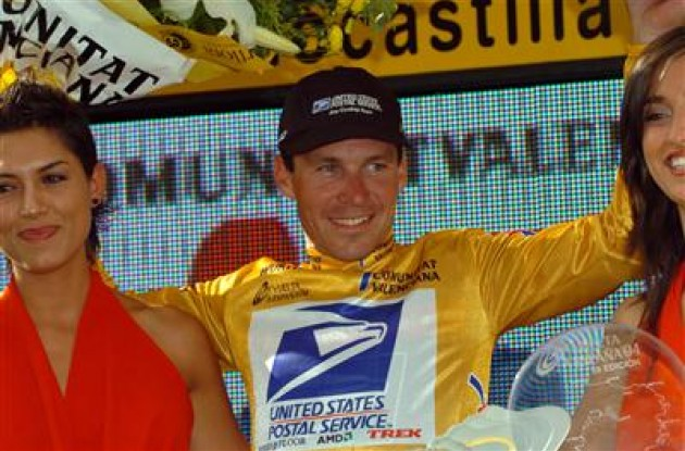 Max van Heeswijk on the podium in the golden leader's jersey.