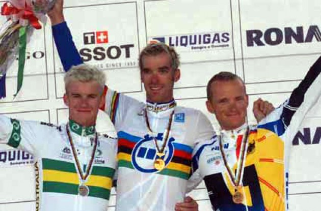 Look who's happy now! Millar and co. on the podium. Photo copyright Fotoreporter Sirotti.